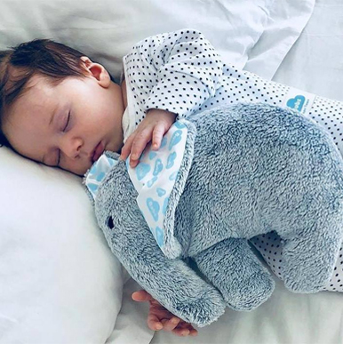 Sleeping baby clutching a Bubs for Babes Ellie Comforter
